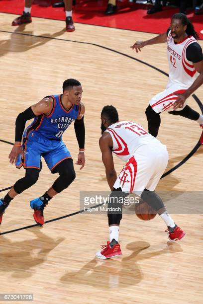 James Harden of the Houston Rockets handles the ball during the game against Russell Westbrook of the Oklahoma City Thunder in Game Five of the...
