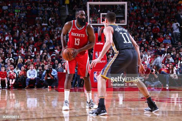 James Harden of the Houston Rockets handles the ball during the game against the Golden State Warriors on January 20 2018 at the Toyota Center in...