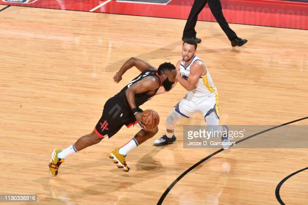 James Harden of the Houston Rockets handles the ball Stephen Curry of the Golden State Warriors on March 13 2019 at the Toyota Center in Houston...