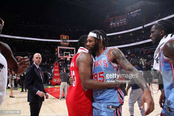 James Harden of the Houston Rockets hugs DeAndre' Bembry of the Atlanta Hawks after the game on March 19 2019 at State Farm Arena in Atlanta Georgia...