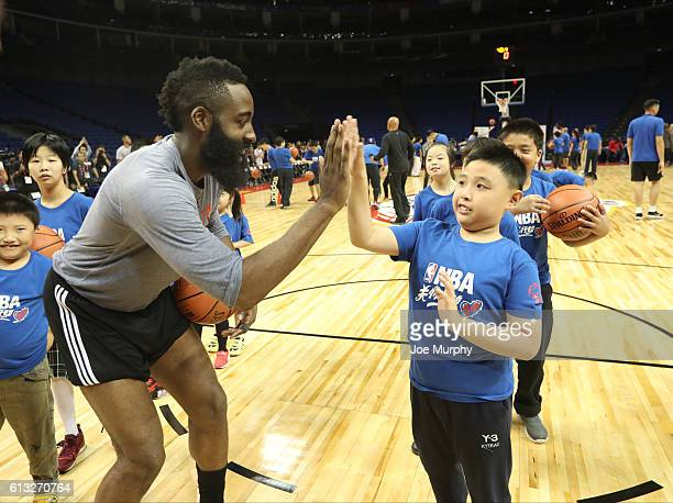 James Harden of the Houston Rockets interacts with a participant during the Special Olympics NBA Cares Clinic as part of the 2016 Global Games China...