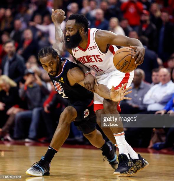 James Harden of the Houston Rockets is defended by Kawhi Leonard of the Los Angeles Clippers during the fourth quarter at Toyota Center on November...