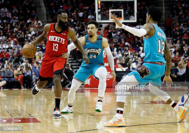 James Harden of the Houston Rockets is double teamed by Dillon Brooks of the Memphis Grizzlies and Ja Morant during the fourth quarter at Toyota...