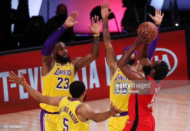 James Harden of the Houston Rockets is fouled as LeBron James of the Los Angeles Lakers, Markieff Morris of the Los Angeles Lakers and Talen...