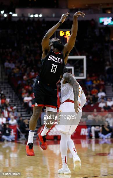 James Harden of the Houston Rockets is fouled by DeAndre' Bembry of the Atlanta Hawks as he shoots during the first quarter at Toyota Center on...