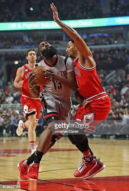 James Harden of the Houston Rockets is fouled by Derrick Rose of the Chicago Bulls at the United Center on March 5 2016 in Chicago Illinois NOTE TO...