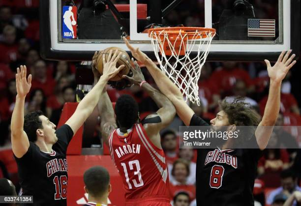 James Harden of the Houston Rockets is fouled on the shot by Robin Lopez of the Chicago Bulls in the first half at Toyota Center on February 3 2017...