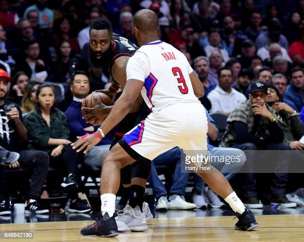 James Harden of the Houston Rockets is guarded by Chris Paul of the LA Clippers during the first half at Staples Center on March 1 2017 in Los...