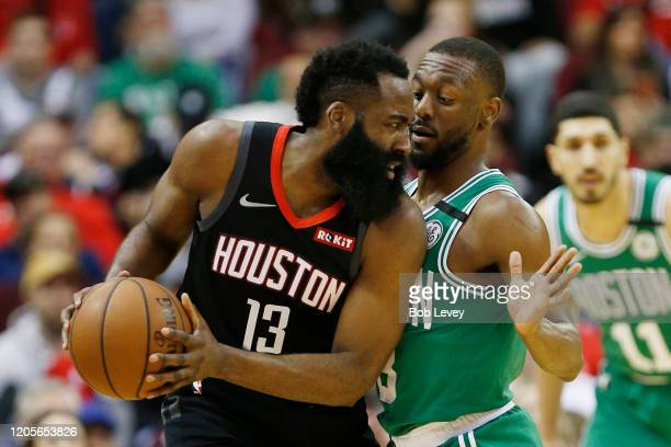 James Harden of the Houston Rockets is guarded by Kemba Walker of the Boston Celtics at Toyota Center on February 11 2020 in Houston Texas NOTE TO...
