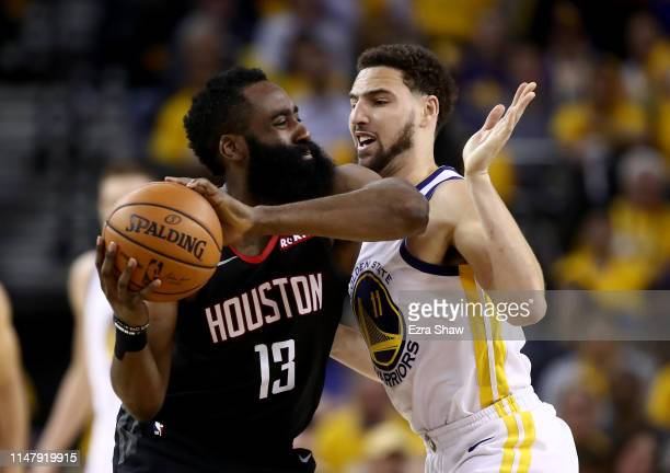 James Harden of the Houston Rockets is guarded by Klay Thompson of the Golden State Warriors during Game Five of the Western Conference Semifinals of...