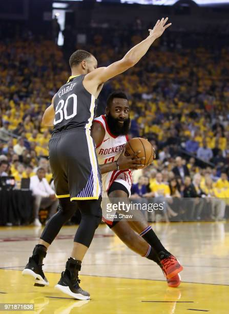 James Harden of the Houston Rockets is guarded by Stephen Curry of the Golden State Warriors during Game 4 of the Western Conference Finals at ORACLE...