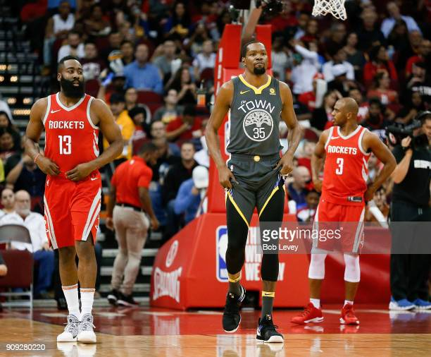 James Harden of the Houston Rockets Kevin Durant of the Golden State Warriors and Chris Paul of the Houston Rockets at Toyota Center on January 20...