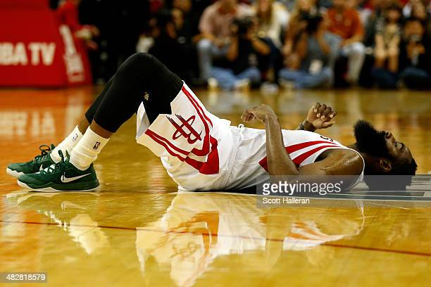 James Harden of the Houston Rockets lays on the court in the second period after a play against the Oklahoma City Thunder during a game at the Toyota...
