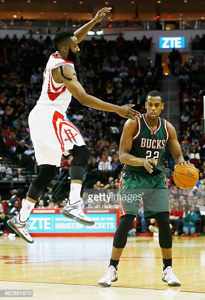 James Harden of the Houston Rockets leaps as he guards Khris Middleton of the Milwaukee Bucks during their game at the Toyota Center on February 6...