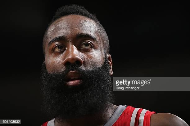 James Harden of the Houston Rockets looks on against the Denver Nuggets at Pepsi Center on December 14 2015 in Denver Colorado The Nuggets defeated...