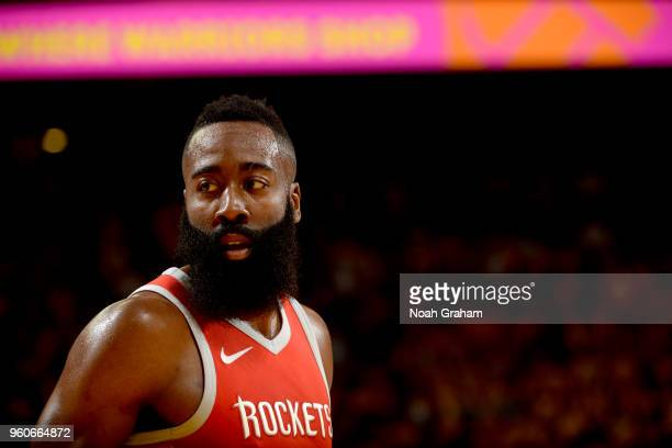 James Harden of the Houston Rockets looks on during the game against the Golden State Warriors in Game Three of the Western Conference Finals of the...
