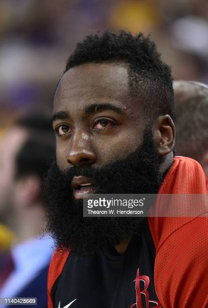 James Harden of the Houston Rockets looks on from the bench after returning from the locker room and having his left eye looked at while playing the...