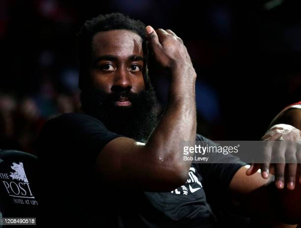 James Harden of the Houston Rockets looks on from the bench during the fourth quarter against the New York Knicks at Toyota Center on February 24...