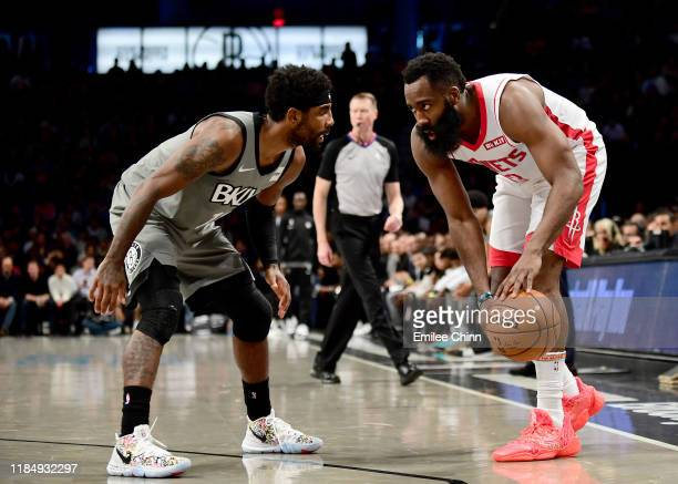 James Harden of the Houston Rockets looks to drive past Kyrie Irving of the Brooklyn Nets during the first half of their game at Barclays Center on...