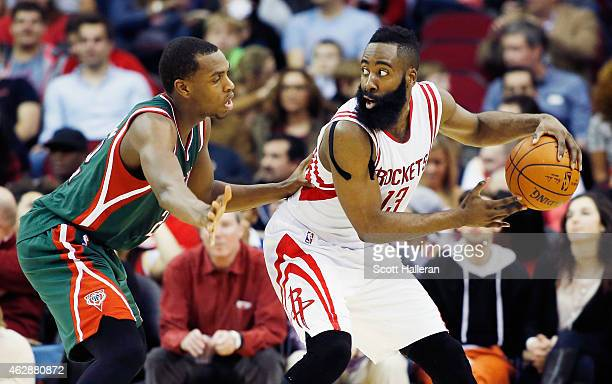 James Harden of the Houston Rockets looks to drive with the basketball as Khris Middleton of the Milwaukee Bucks defends during their game at the...
