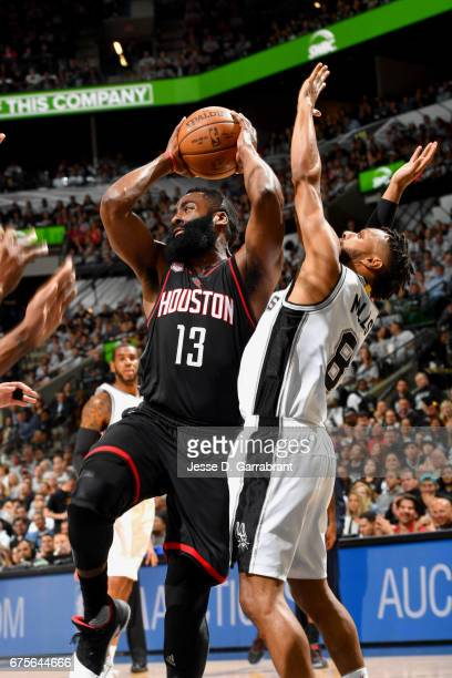 James Harden of the Houston Rockets looks to pass the ball against the San Antonio Spurs during Game One of the Western Conference Semifinals of the...