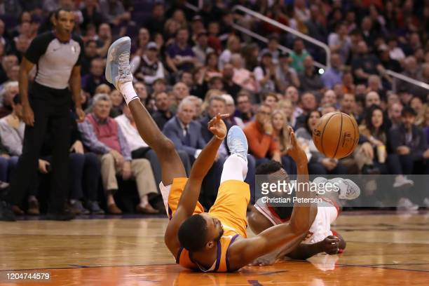James Harden of the Houston Rockets looses the ball while defended by Mikal Bridges of the Phoenix Suns during the first half of the NBA game at...