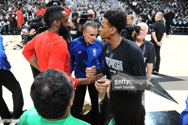 James Harden of the Houston Rockets meets with Dejounte Murray of the San Antonio Spurs before Game One of the Western Conference Semifinals of the...
