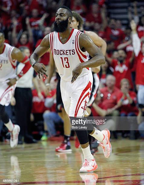 James Harden of the Houston Rockets motions after a three point shot against the Portland Trail Blazers in Game One of the Western Conference...
