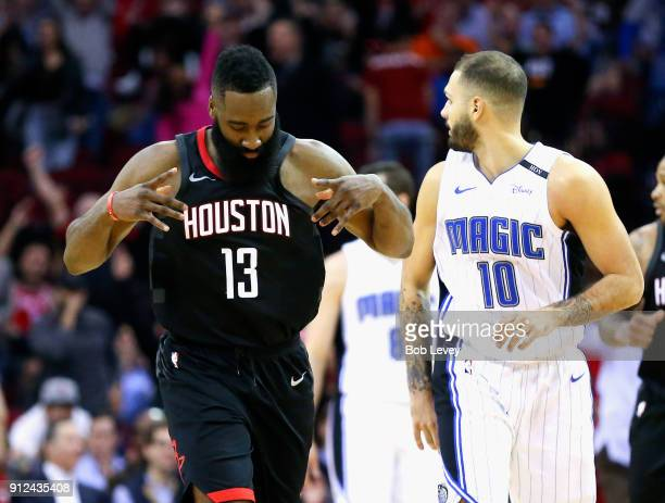 James Harden of the Houston Rockets motions after makling a threepoint shot against the Orlando Magic at Toyota Center on January 30 2018 in Houston...