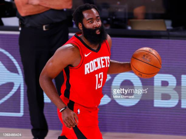 James Harden of the Houston Rockets moves the ball against the Milwaukee Bucks at The Arena at ESPN Wide World Of Sports Complex on August 02, 2020...