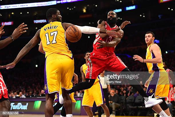 James Harden of the Houston Rockets passes behind Roy Hibbert of the Los Angeles Lakers during the first half at Staples Center on December 17 2015...