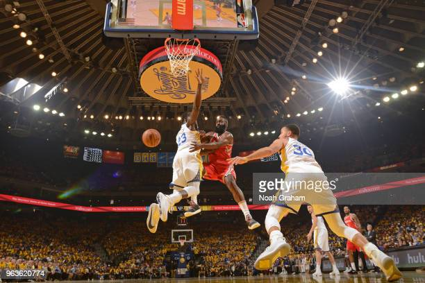 James Harden of the Houston Rockets passes the ball against Draymond Green of the Golden State Warriors during Game Six of the Western Conference...