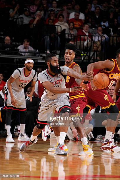 James Harden of the Houston Rockets passes the ball against the Cleveland Cavaliers during the game on January 15 2016 at Toyota Center in Houston...
