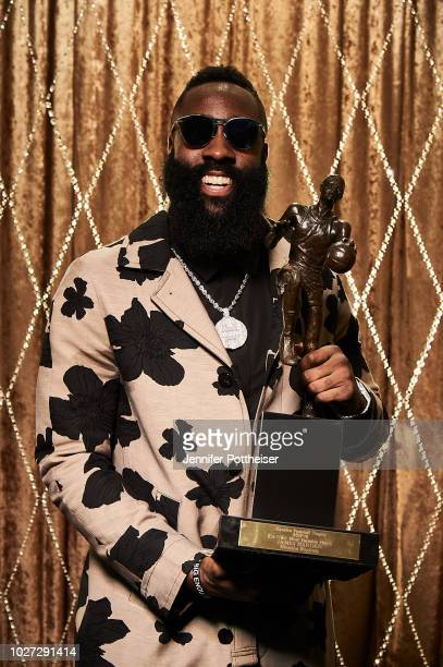 James Harden of the Houston Rockets poses for a portrait with the Maurice Podoloff Trophy after winning NBA Most Valuable Player Award during the NBA...
