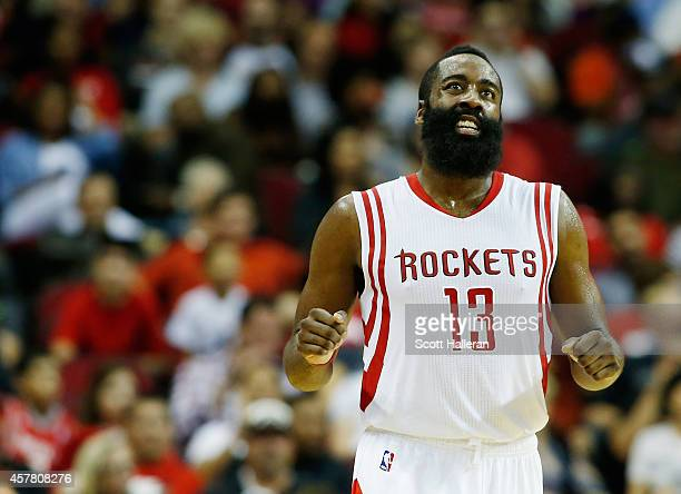 James Harden of the Houston Rockets reacts after a missed threepoint shot during their preseason game against the San Antonio Spurs at Toyota Center...