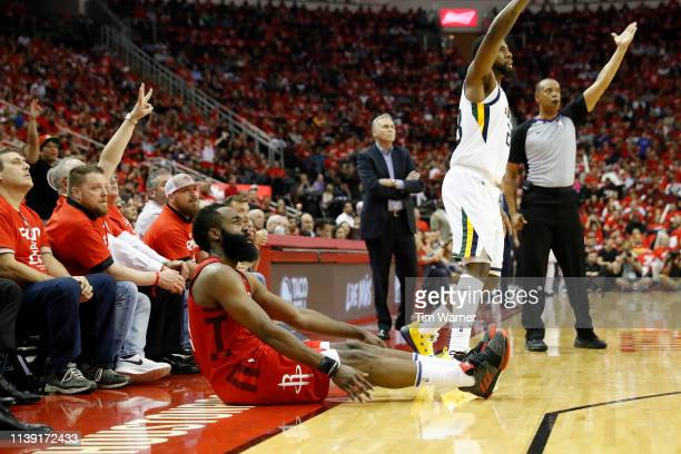 James Harden of the Houston Rockets reacts after a three point shot defended by Royce O'Neale of the Utah Jazz in the second half during Game Five of...