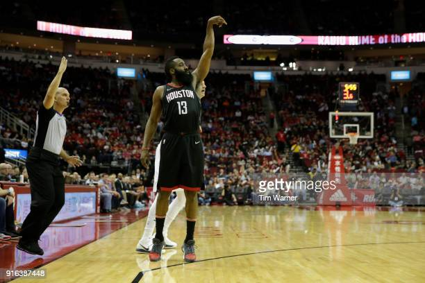 James Harden of the Houston Rockets reacts after a three point shot in the first half against the Denver Nuggets at Toyota Center on February 9 2018...