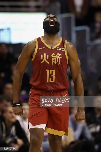James Harden of the Houston Rockets reacts after hitting a threepoint shot against the Phoenix Suns during the second half of the NBA game at Talking...