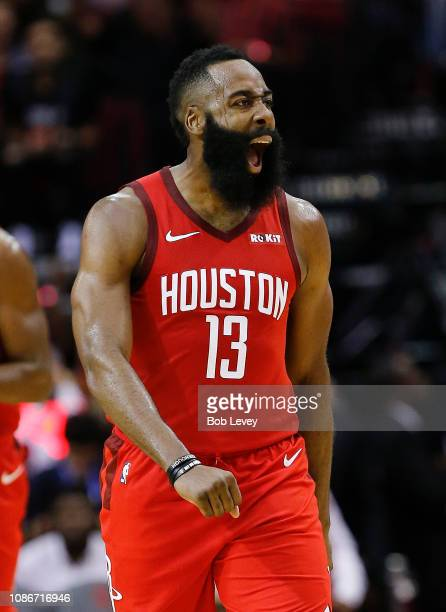 James Harden of the Houston Rockets reacts after making a three point basket during the fourth