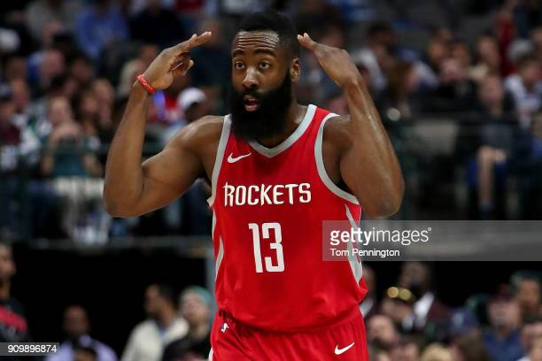 James Harden of the Houston Rockets reacts after scoring against the Dallas Mavericks at American Airlines Center on January 24 2018 in Dallas Texas...