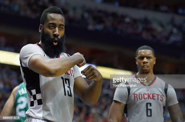 James Harden of the Houston Rockets reacts against the Dallas Mavericks in the fourth quarter at American Airlines Center on December 4 2015 in...