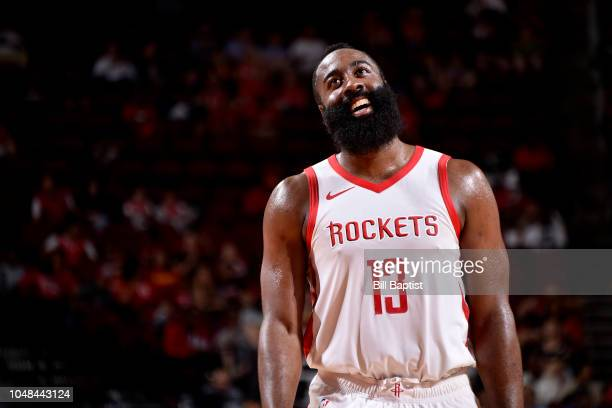 James Harden of the Houston Rockets reacts during a preseason game against the Shanghai Sharks on October 9 2018 at Toyota Center in Houston Texas...