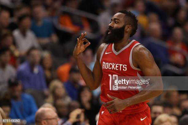 James Harden of the Houston Rockets reacts to a three point shot against the Phoenix Suns during the second half of the NBA game at Talking Stick...
