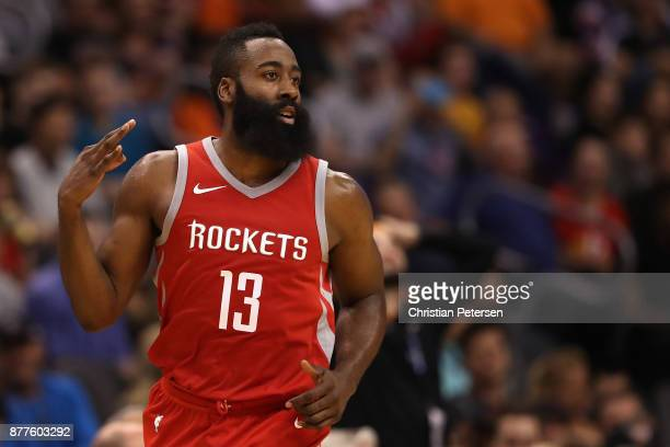 James Harden of the Houston Rockets reacts to a three point shot during the first half of the NBA game against the Phoenix Suns at Talking Stick...