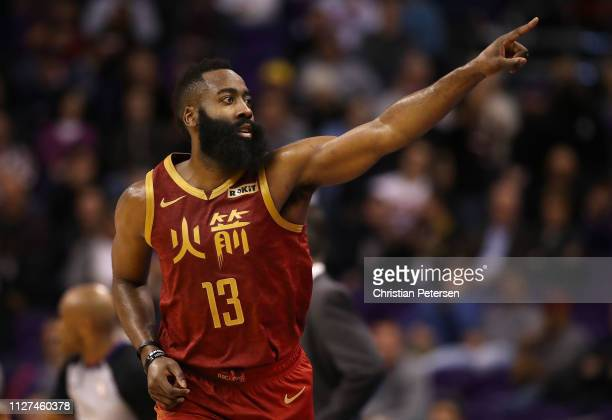 James Harden of the Houston Rockets reacts to a threepoint shot against the Phoenix Suns during the second half of the NBA game at Talking Stick...