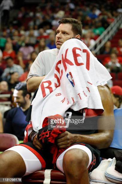 James Harden of the Houston Rockets receives a massage to his neck in the first half against the Minnesota Timberwolves at Toyota Center on March 17...