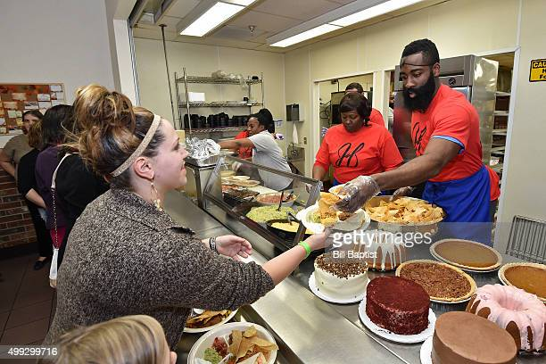 James Harden of the Houston Rockets serves dinner for people during a thanksgiving event on November 24 2015 in Houston Texas NOTE TO USER User...
