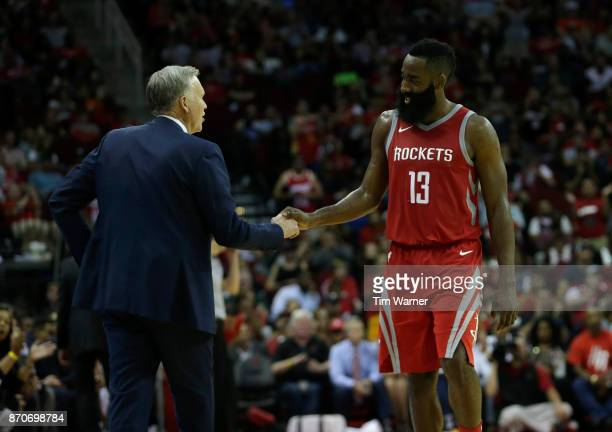 James Harden of the Houston Rockets shakes hands with head coach Mike D'Antoni in the second half against the Utah Jazz at Toyota Center on November...