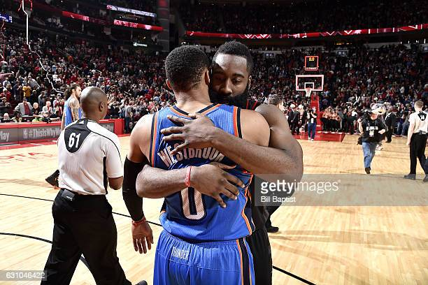 James Harden of the Houston Rockets shares a hug with Russell Westbrook of the Oklahoma City Thunder after the game on January 5 2017 at the Toyota...