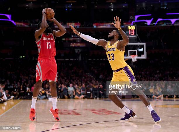 James Harden of the Houston Rockets shoots a jumper in front of LeBron James of the Los Angeles Lakers during a 124115 Rockets win at Staples Center...